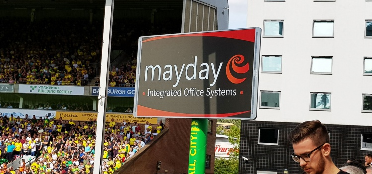 Mayday Sponsors Matchday Team Sheets & Advertises at Carrow Road